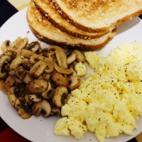 Healthy meal with mushroom egg on toast